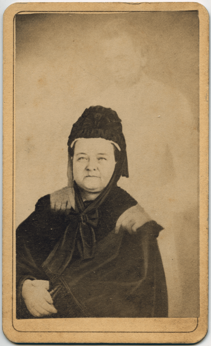"""Figure 2. William Mumler, Mary Todd Lincoln with the ghost of her husband, President Abraham Lincoln, and her son Thaddeus, 1872. Source: Piepenbring, Dan. """"The Photographer Who Claimed to Capture Abraham Lincoln's Ghost."""" The New Yorker, 27 October 2017. https://www.newyorker.com/culture/photobooth/ photographer-who-claimed-to-capture-abraham-lincoln-ghost."""