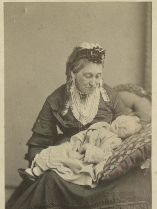 """Figure 3. Old woman with baby on her lap. Source: Royal, Simon. """"Victorian-Era Photographs of the Dead Reveal Moments of Tenderness."""" ABC News, 27 June 2015. https://www.abc.net.au/news/2015-06-27/victorian-era-photos-ofdeceased- fascinate-modern-viewers/6575580."""