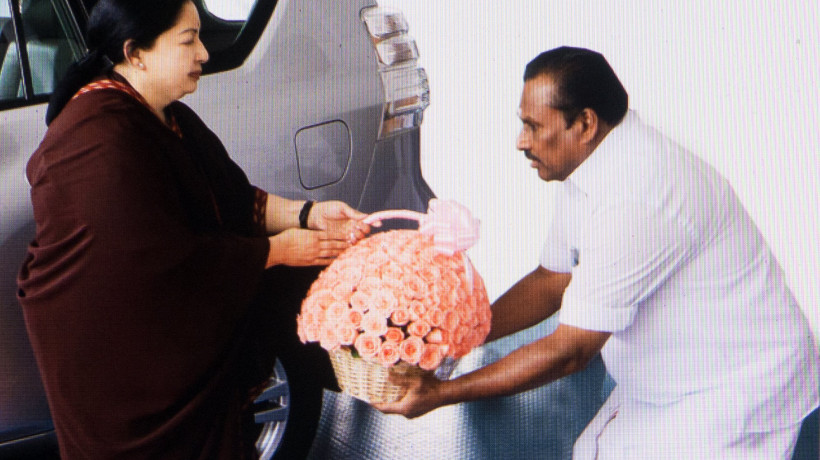 Jayalalithaa being offered a bouquet by the ministers of her party. Among them the incumbent prime minister of India Narendra Modi.